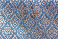 Gardenia Designed Thai Silk. A beautiful piece of very fine Thai silk of silver gardenia on blue blackground Stock Images