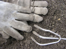 Gardening. Worn gloves and tool Royalty Free Stock Photos