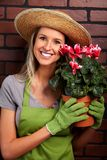 Gardening. Woman worker with flowers stock images