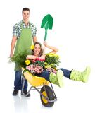 Gardening. People workers with flowers. Isolated over white background stock photo
