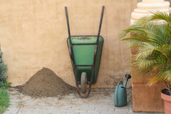 Gardening. Wheelbarrow and Watering Can Royalty Free Stock Image