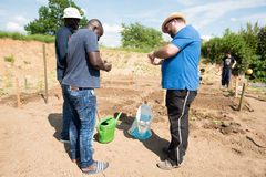 Gardening activities in a German refugee camp Royalty Free Stock Photos