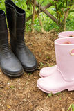 Gardening boots in garden. Royalty Free Stock Images