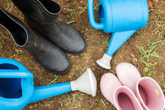 Gardening boots in garden. Royalty Free Stock Photography