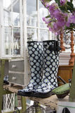 Gardening boots and supplies for sale. Royalty Free Stock Image