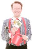 Gardening business money. Young businessman holding some euro banknotes and a watering pot for your environmental and gardening concepts or as a business Royalty Free Stock Photos