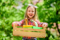 Gardening classes. Inspect garden daily spot insect trouble early. Ecology education. Little girl planting plants. Day. At farm. Planting flowers. Plant veggies stock image