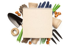 Gardening Concept Isolated on White Background. Gardening concept. Blank notebook over gardening tools isolated on white background. Copy space. Top view Royalty Free Stock Images
