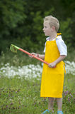 Gardening, cute little boy with rake, outdoors Stock Photo