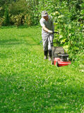 Gardening - cutting the grass Royalty Free Stock Photo