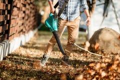 Gardening - professional landscaper using leaf blower. Gardening details - professional landscaper using leaf blower stock photography