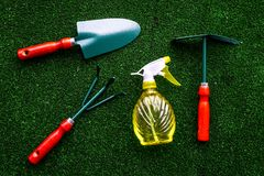 Gardening equipment concept on green grass background top view Stock Photos