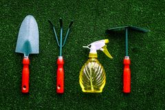Gardening equipment concept on green grass background top view Royalty Free Stock Photo