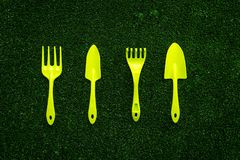 Gardening equipment concept on green grass background top view Stock Images