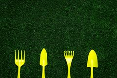 Gardening equipment concept on green grass background top view copy space Royalty Free Stock Photography