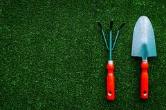 Gardening equipment concept on green grass background top view copyspace Stock Image