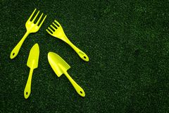 Gardening equipment concept on green grass background top view copyspace Royalty Free Stock Photo