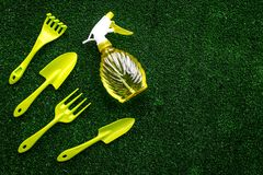 Gardening equipment concept on green grass background top view copy space Stock Images