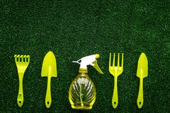 Gardening equipment concept on green grass background top view copy space Royalty Free Stock Image