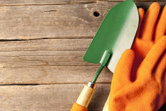 Gardening equipment on rustic wooden boards Royalty Free Stock Images