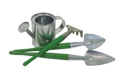 Gardening essentials. Including watering can and tools - path included Stock Photos