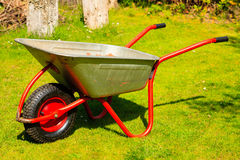 Gardening. Garden metal wheelbarrow. Stock Photos