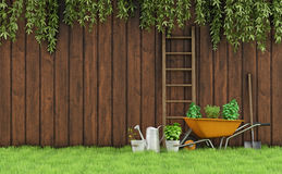 Gardening. Garden with an old wooden fence and tools for gardening-3D Rendering stock illustration