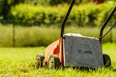Gardening. Mowing lawn with lawnmower Stock Image