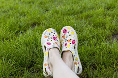 Gardening. Garden shoes on the lawn Royalty Free Stock Images