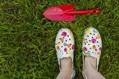 Gardening. Garden shoes on the lawn Stock Photos