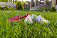 Gardening. Garden shoes on the lawn Royalty Free Stock Image