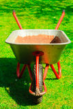 Gardening. Garden wheelbarrow with sand soil. Stock Photo