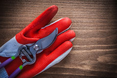 Gardening glove and stainless secateurs on wooden background Stock Images