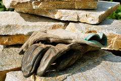 Gardening gloves on stone Royalty Free Stock Image