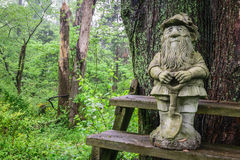 Gardening gnome in the forest Royalty Free Stock Images