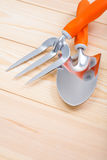 Gardening hand tools spade and fork on wooden boards Royalty Free Stock Photo