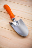 Gardening hand tools - trowel and fork on wooden boards Stock Images