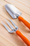Gardening hand tools - trowel and fork on wooden boards Stock Image