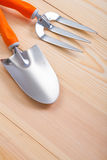 Gardening hand tools - trowel and fork on wooden boards Royalty Free Stock Photography