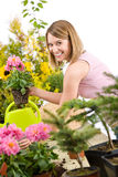 Gardening - Happy woman holding flower pot Stock Photography