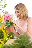 Gardening - Happy woman holding flower pot Royalty Free Stock Image