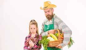Gardening and harvesting. Family farm organic vegetables. Man bearded rustic farmer with kid. Farmers family homegrown. Harvest. Father farmer or gardener with stock photos