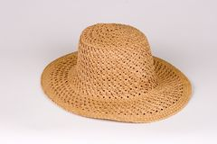 Gardening Hat. Isolated View of a Beige Wicker Gardening Hat Stock Photos