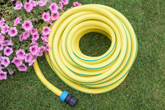 Gardening- hose-pipe on the grass Stock Images