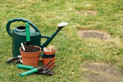 Gardening implements on the grass lawn Stock Photo