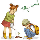 Gardening kids Stock Images