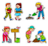Gardening kids. Kids working in the garden and planting things Royalty Free Stock Photo