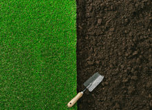 Gardening and landscaping. Gardening shovel on the fertile soil and grass, gardening and landscaping concept stock images