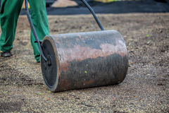 Gardening with lawn roller Stock Photos