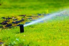Free Gardening. Lawn Sprinkler Spraying Water Over Grass. Stock Photography - 46893952